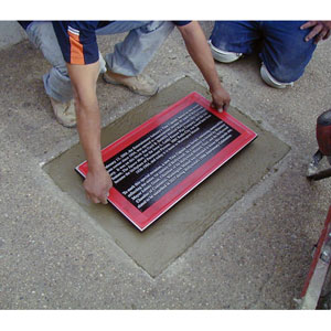 Plaque is put in place