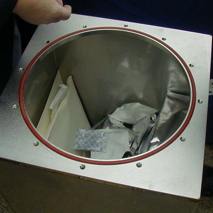 Putting items into bolted time capsule